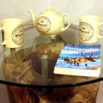 tavolino da salotto con vetro su tronco