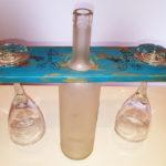 porta calici con bottiglia centrale di supporto (b)