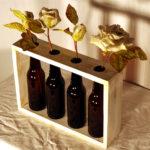 porta fiori da tavolo con bottiglie